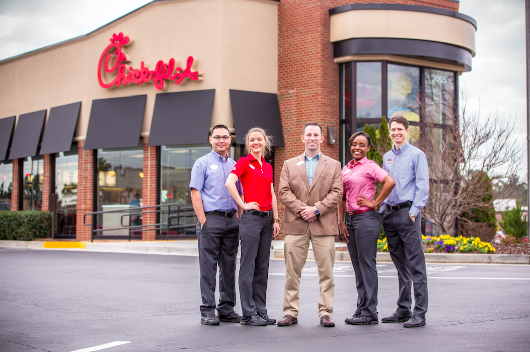 Zach Thomas (center), CFA Owner/Operator in Marietta, Georgia